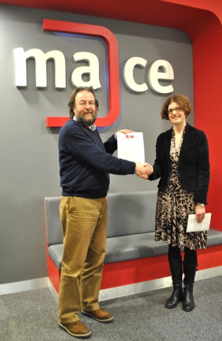 Dr Emma Jay presented MACE's Director, James Patterson with the Archive Accreditation Certificate